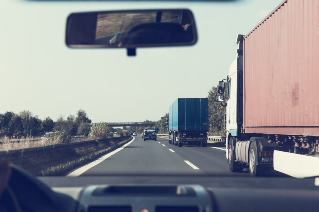 cockpit view of trucks on highway with navigation